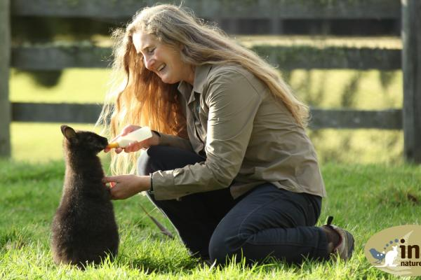 Tonia Cochran - Feeding an orphan Wallaby