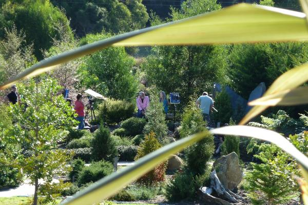 Tonia Cochran and Ernie Dingo filming in the Jurassic Garden